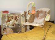 Кресло-качалка Fisher Price c сердцебиением для младенцев.